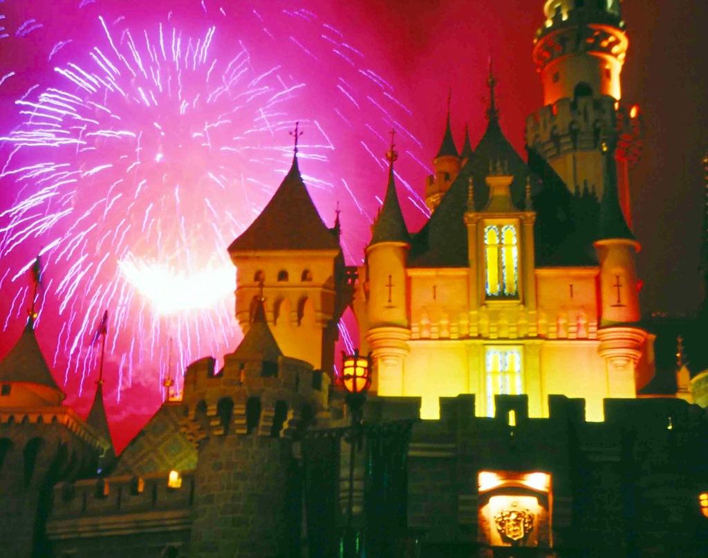 The castle at Disneyland under fireworks.